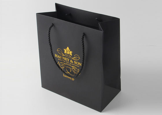 China Reusable Black Paper Boutique Shopping Bags Imprinted With Silver Stamping supplier