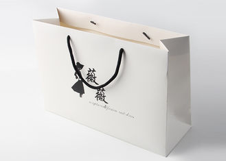 China Matte Laminated White Paper Shopping Bags With Cardboard Bottom Insert supplier