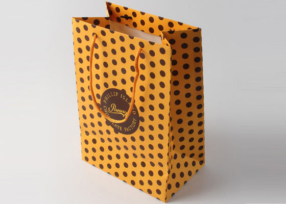 China Nylon Handle Decorative Gift Packing Bags With Gold Foil Hot Stamp And Dot Pattern supplier